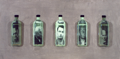 Sand-coated box with bottles filled with water, images and internal lighting, 60 x 30 x 20 cm, 1994.