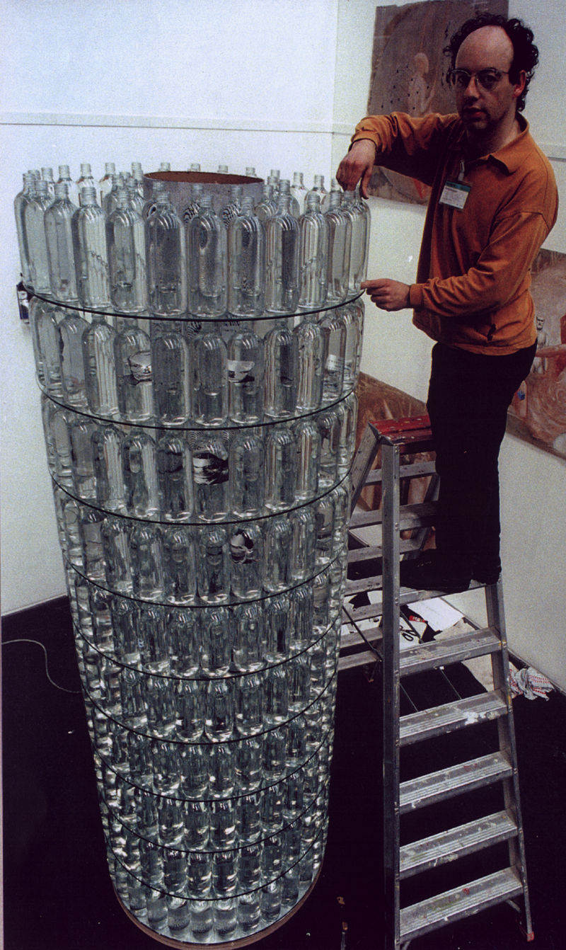 860 Janever bottles filled with water, with photo-images, and glass, Height 4 metres, diameter 89 cm, 1996.